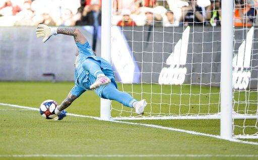 Portland Timbers goalkeeper Steve Clark makes a save on a penalty kick by Real Salt Lake in the first half of an MLS soccer match Saturday, May 4, 2019, at Rio Tinto Stadium in Sandy, Utah. (Leah Hogsten/The Salt Lake Tribune via AP)