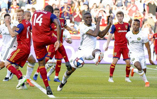 Real Salt Lake defender Nedum Onuoha (14) line-drives against Portland Timbers defender Larrys Mabiala (33) on a corner kick during an MLS soccer match Saturday, May 4, 2019, at Rio Tinto Stadium in Sandy, Utah. (Leah Hogsten/The Salt Lake Tribune via AP)