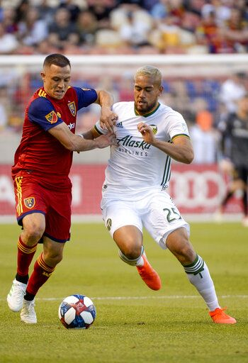 Real Salt Lake defender Donny Toia, left, and Portland Timbers defender Bill Tuiloma (25) vie for possession of the ball during an MLS soccer match Saturday, May 4, 2019, at Rio Tinto Stadium in Sandy, Utah. (Leah Hogsten/The Salt Lake Tribune via AP)