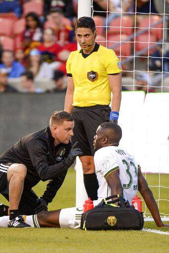 Portland Timbers defender Larrys Mabiala (33) is checked for a concussion during the first half of the team's MLS soccer match against the Portland Timbers, Saturday, May 4, 2019, in Sandy, Utah. (Leag Hogsten/The Salt Lake Tribune via AP)