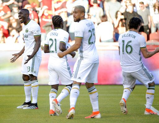 Portland Timbers defender Larrys Mabiala (33) reacts to Timbers goalkeeper Steve Clark (12) saving a penalty kick off Real Salt Lake midfielder Albert Rusnak (11) in the first half of an MLS soccer match Saturday, May 4, 2019, at Rio Tinto Stadium in Sandy, Utah. (Leah Hogsten/The Salt Lake Tribune via AP)