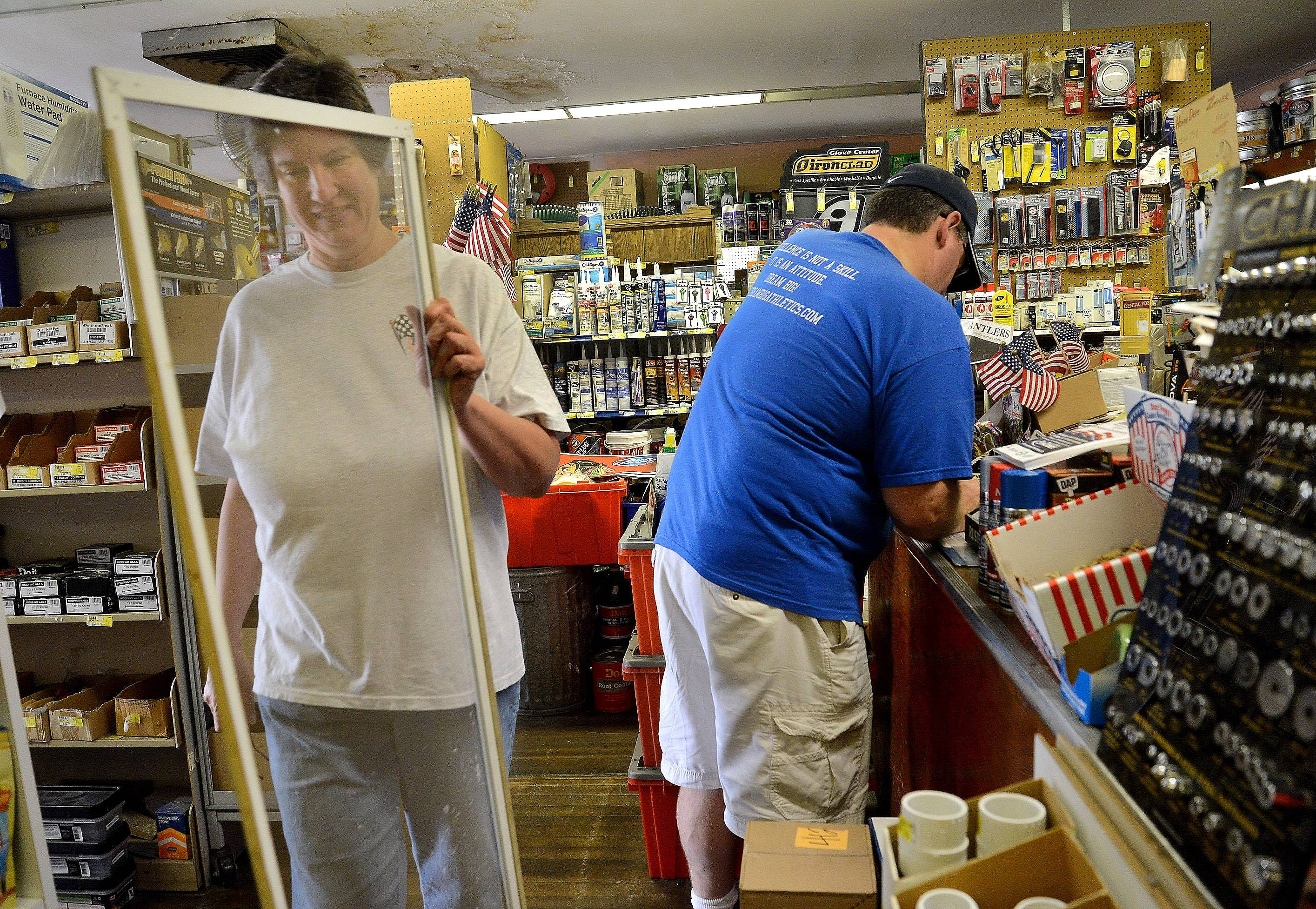 Nancy Martino, owner of Zimmer Hardware in Palatine, helps a customer with a screen for a door in 2015. Zimmer's streak of being in business for 136 consecutive years ended in March.