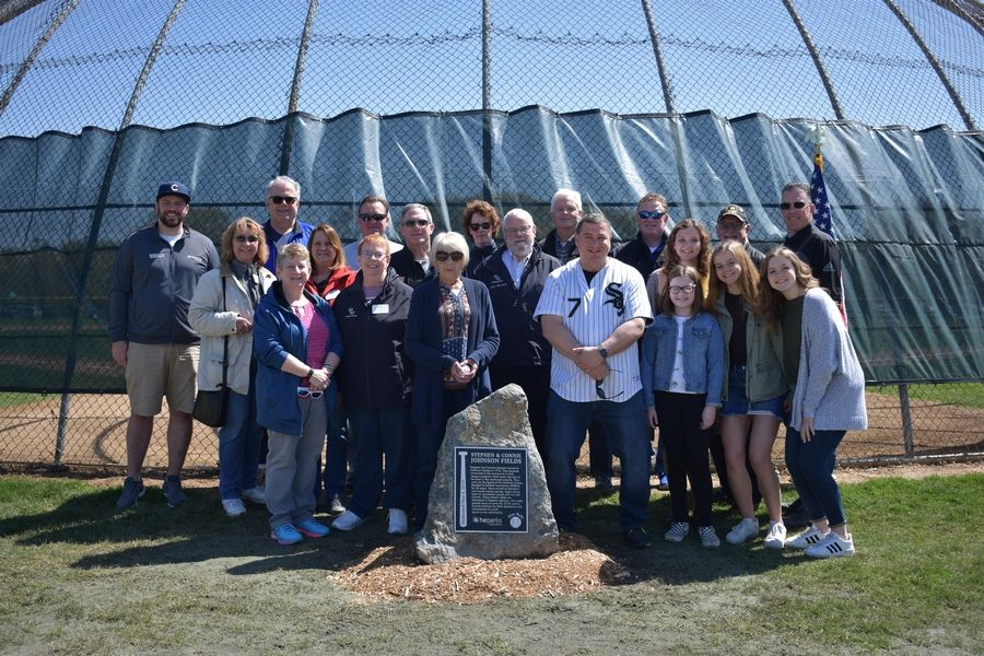 Connie Johnson, Todd Johnson and her granddaughters are joined by members of the Hoffman Estates Park District Board and Representatives from the Village of Hoffman Estates at the dedication of the Connie, Steve and Johnson Fields at Fabbrini Park, Hoffman Estates, May 4, 2019.Hoffman Estates Park District