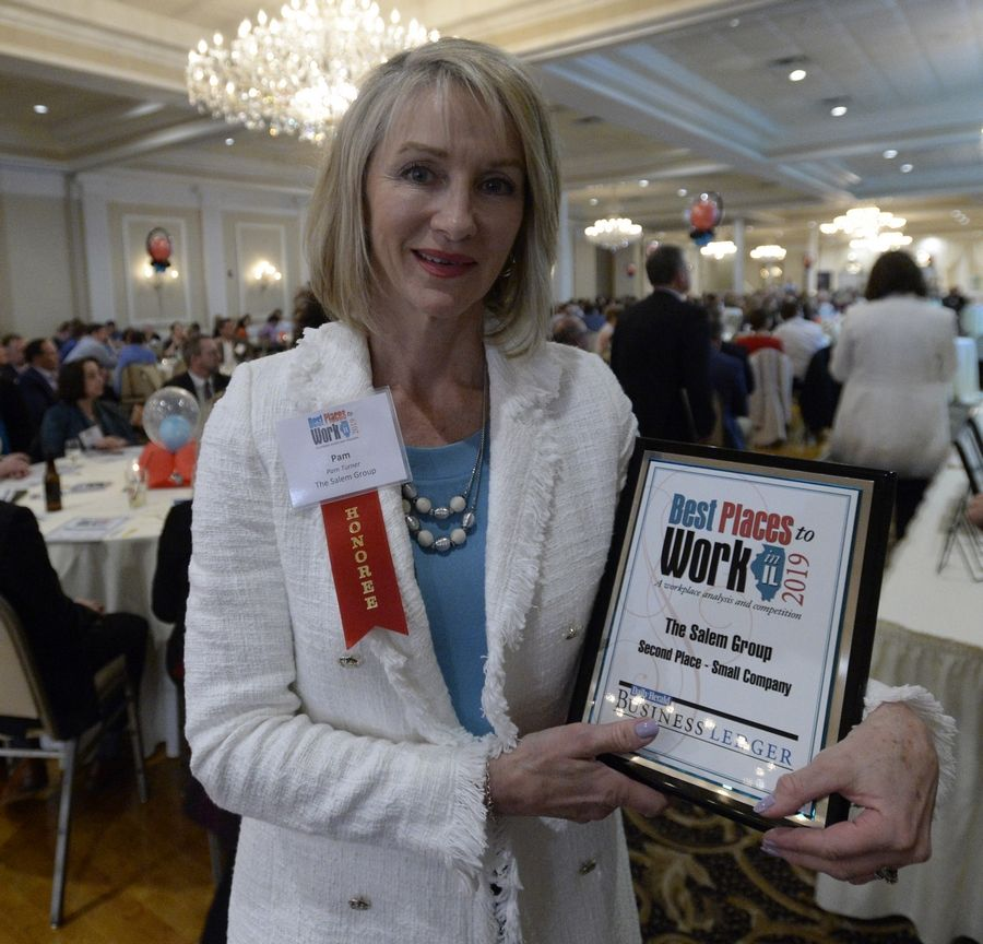Pam Turner from the Salem Group claims second place in the Small Company division at the Best Places to Work in Illinois Ceremony as part of the Daily Herald and Business Ledger.