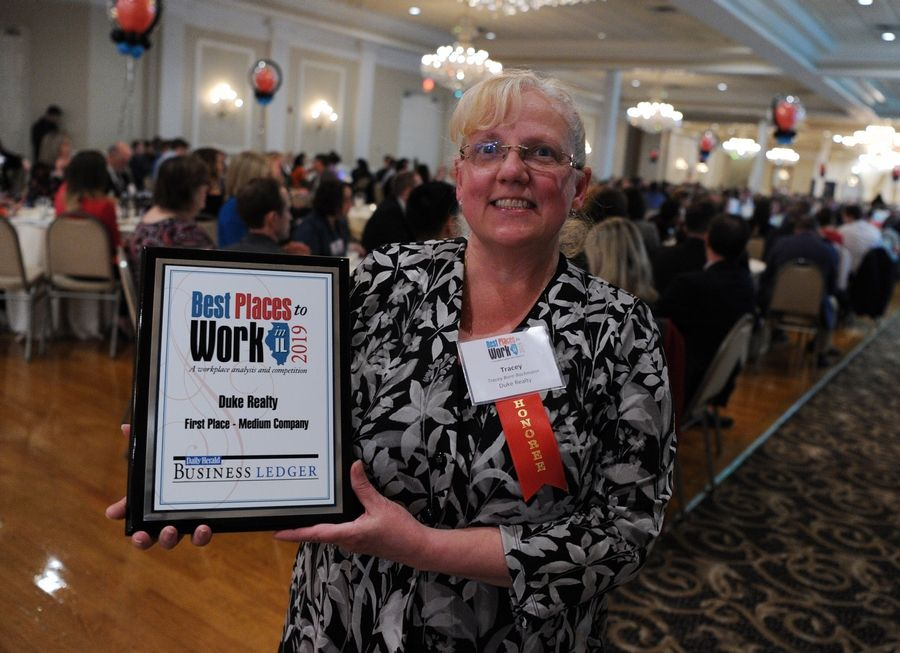 Tracey Born-Bachmann of Duke Realty claims first place for medium companies at the Daily Herald Business Ledger's Best Places to Work in Illinois awards ceremony Thursday.