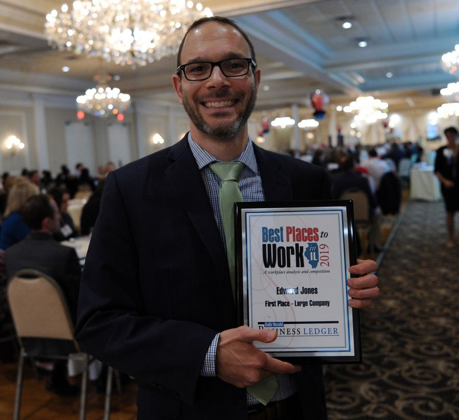 Mark Farina, financial adviser at Edward Jones, claims first place in the Large Company division at the Best Places to Work in Illinois ceremony on Thursday.