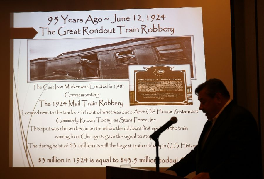 "Green Oaks Mayor Bernard Wysocki talks about the Great Rondout Train Robbery during the annual GLMV Annual ""Ask The Mayors"" luncheon Thursday in Mundelein."