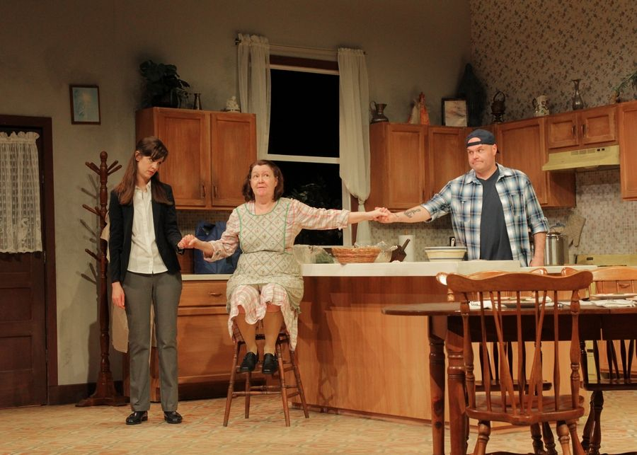 "A Buffalo, New York family -- daughter Ruth (Rebecca Cox), left, mom Clara (Millie Hurley) and son Jimmy (Nick DuFloth) -- maintain the miracle that occurred years earlier in Tom Dudzick's family dramedy ""Miracle on South Division Street,"" running through June 2 at Buffalo Theatre Ensemble."