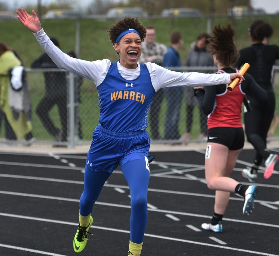 Warren's Janii Jenkins finished the final leg of the 4 x 100 relay and celebrates her team's first-place finish during Thursday's girls track sectional in Antioch.