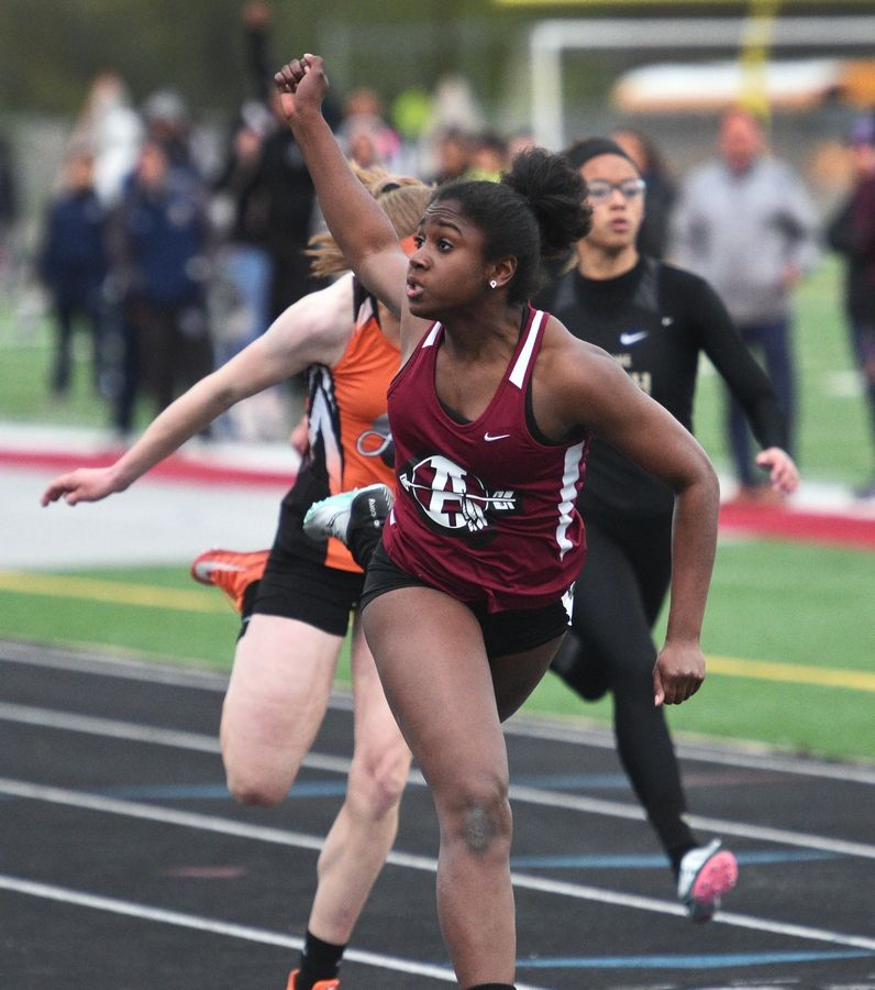 Antioch's Ayanna Tommy crosses the finish line first in the fourth heat of the 100-meter run during Thursday's girls track sectional in Antioch.