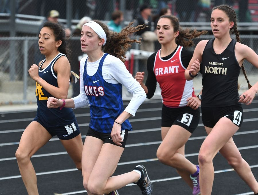 Competing in the 3200-meter run from left is Round Lake's Fatima Giron, Lakes' Brooke Stromsland, Grant's Aly Negovetich and Grayslake North's Kelli Tosic during Thursday's girls track sectional in Antioch.