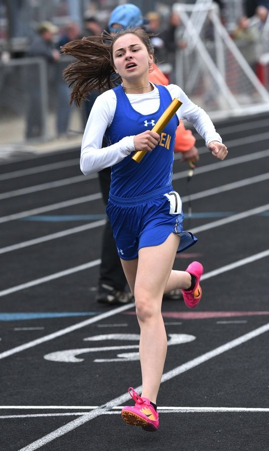 Warren's Hailey Smith finishes the final leg of her team's 4 x 800 relay event during Thursday's girls track sectional in Antioch.