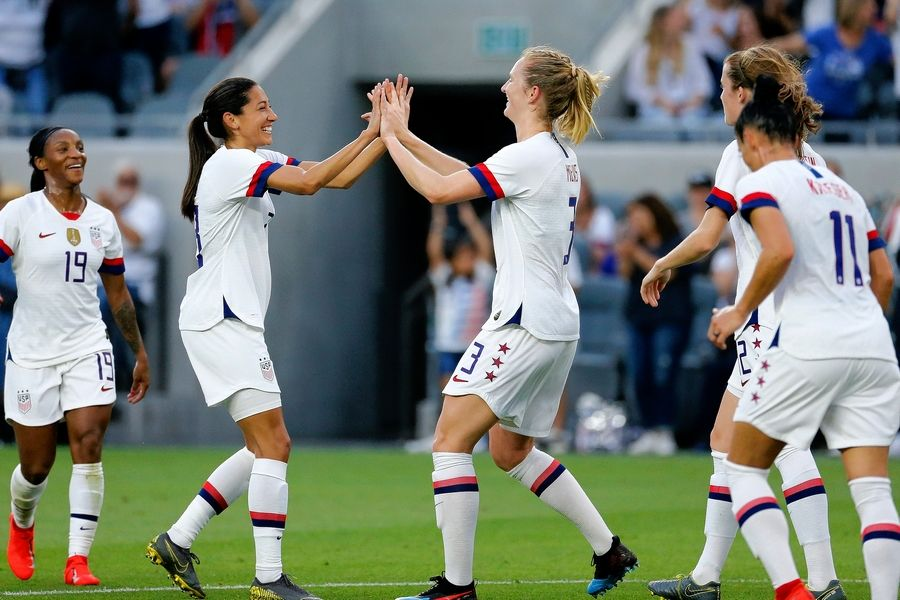 e9c6170ad89 U.S. midfielder Samantha Mewis, center, celebrates her goal with forward  Carli Lloyd, second