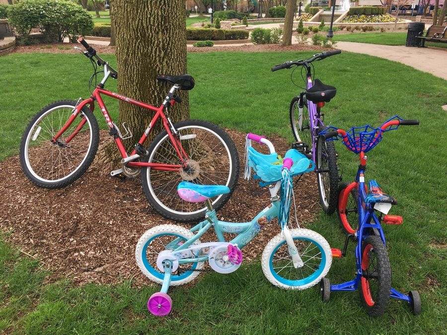 Bikes belonging to the Bradley family of Arlington Heights await riders minutes before the start of the community bike ride Saturday at North School Park in Arlington Heights.
