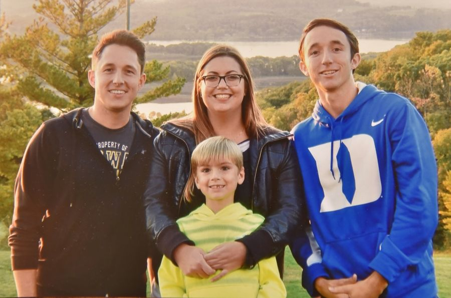 When 18-year-old Maxci LoSchiavo and her baby, Ryan, moved into teacher Cindi Vondrasek's home, they quickly became part of the family. Now Maxci considers Matthew, left, and Jacob, right, her brothers.