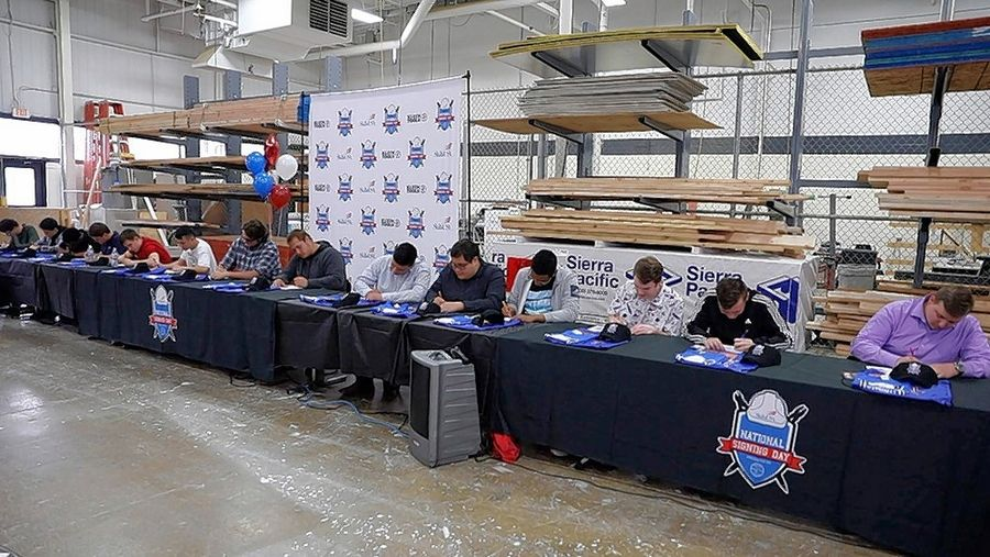 "A total of 20 high school seniors at Technology Center of DuPage were recognized as they signed their ""letters of intent"" for a job offer,"