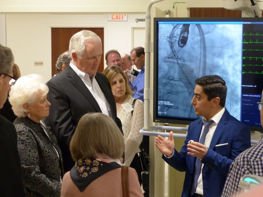 Dr. Maen Nusair, director of the hospital's new structural heart program, demonstrates how doctors are able to replace the aortic valve through a minimally invasive procedure.