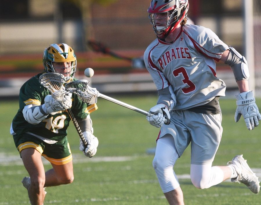 Stevenson's Julio Adjunta, left, and Palatine's Kevin Reynolds (3) chase a loose ball during Monday's boy's lacrosse game in Palatine.