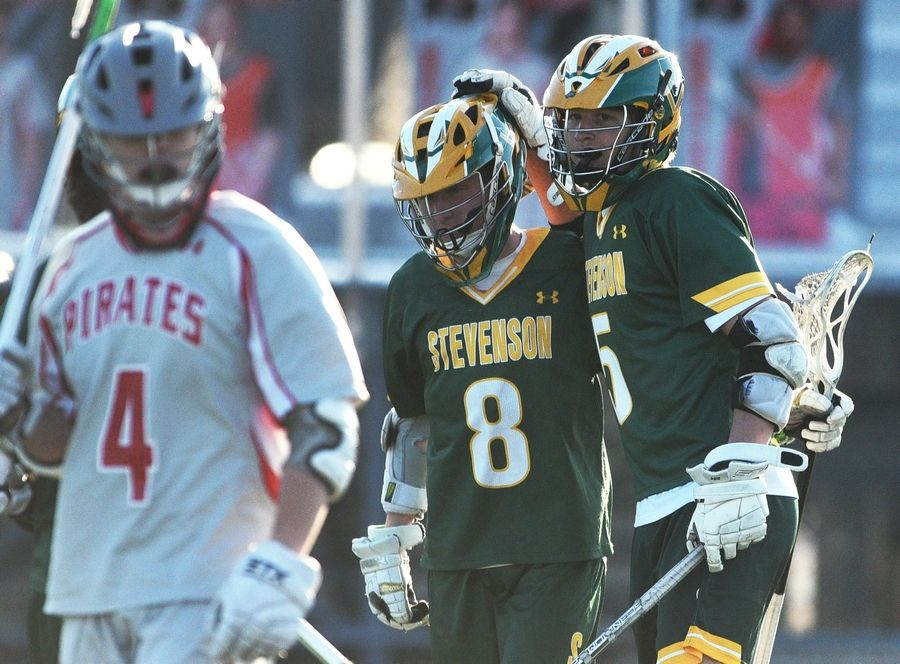 Stevenson's Owen Hancock (8) and Cole Okmin (5) celebrate a first-quarter goal against Palatine during Monday's boy's lacrosse game in Palatine.