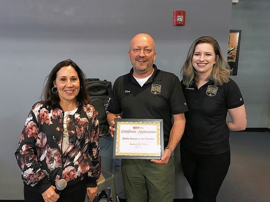 The Lake Zurich Area Chamber of Commerce recently held a Business After Hours at Battle House Tactical Laser Tag, 28039 W Northpointe Parkway. No. 4, Lake Barrington. From left are Ginny Opsahl, Chamber president; Douglas Huckbody, CEO/Managing Partner of Battle House; and Alexandra Loppnow, general manager Battle House.