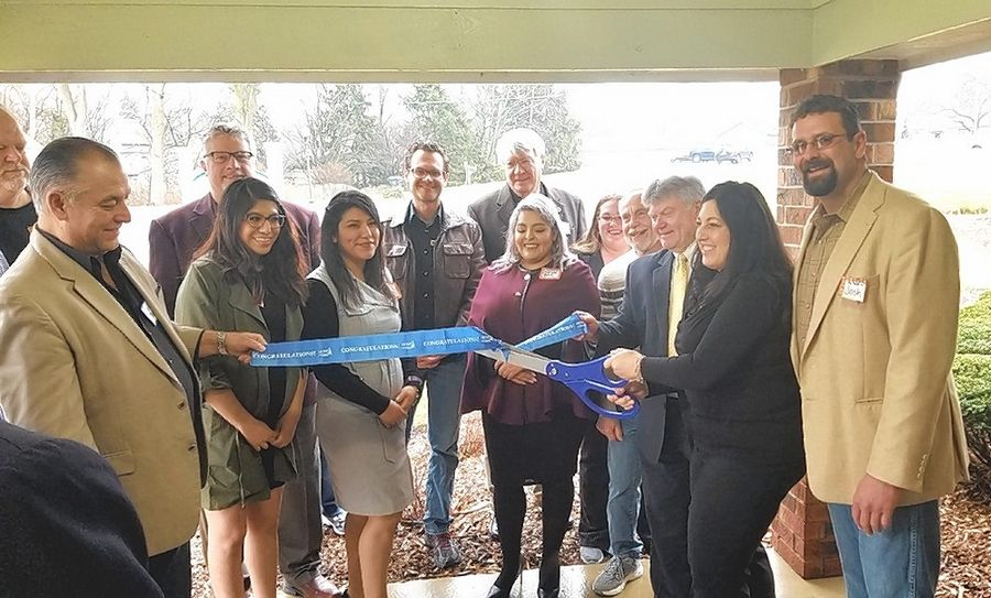 The Geneva Chamber of Commerce held a ribbon cutting for The Ivy Academy of Early Learning II, 1400 Hill Road, Geneva. Co-Director Stephanie Ensor cuts the ribbon surrounded by family, friends and staff.
