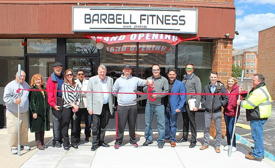 A ribbon-cutting ceremony was held for Barbell Fitness, 13 W. Main St., No. 6, Bensenville. Owner Matt Klusek and Village President Frank DeSimone cut the ceremonial ribbon to celebrate Barbell Fitness's new location, and is joined by family and friends, members of the Bensenville Chamber of Commerce, and village staff.