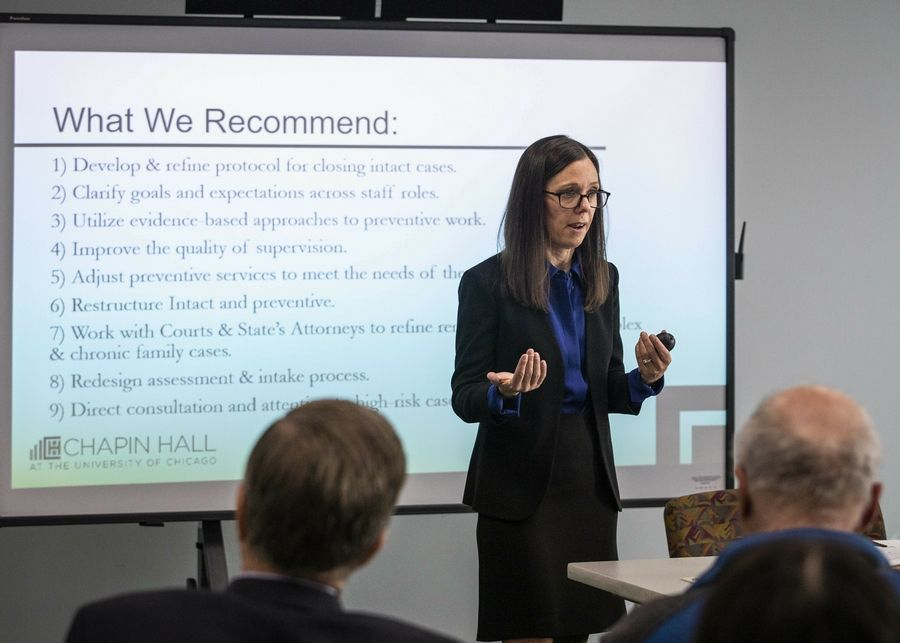In this May 13, 2019 photo, Dana Weiner, policy fellow at Chapin Hall at the University of Chicago, discusses a review of the Illinois Department of Children and Family Services' Intact Family Services program, during a press event at DCFS, in Chicago. A study released Wednesday, May 15, 2019, has found that Illinois' child welfare agency is so intent on keeping children with their parents and not putting them in foster care despite strong indications that they've been physically abused or neglected that it has put those children in greater danger. (Ashlee Rezin/Sun Times via AP)/Chicago Sun-Times via AP)