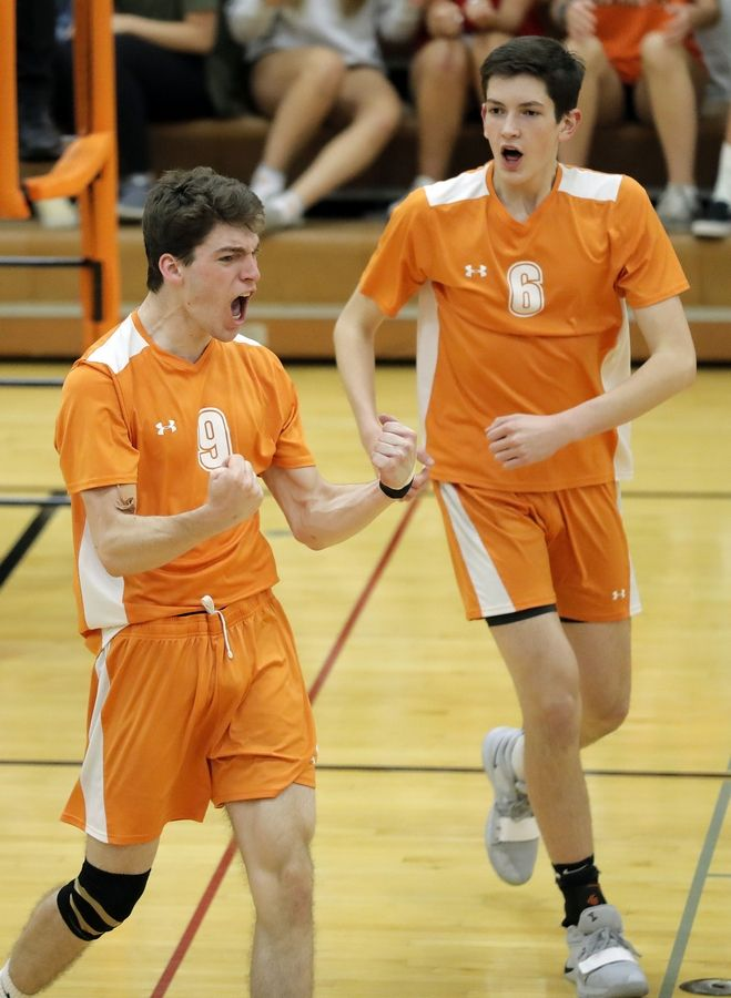 Hersey's Brent Gurvis, left, celebrates during their game against Barrington Wednesday in Arlington Heights.