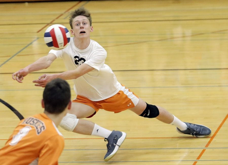 Hersey's Jacob Tolwinski dives for a ball during their game Wednesday in Arlington Heights.