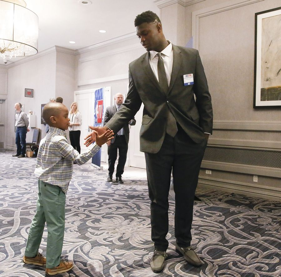 Duke's Zion Williamson, with brother Noah Anderson, before Tuesday's draft lottery in Chicago.