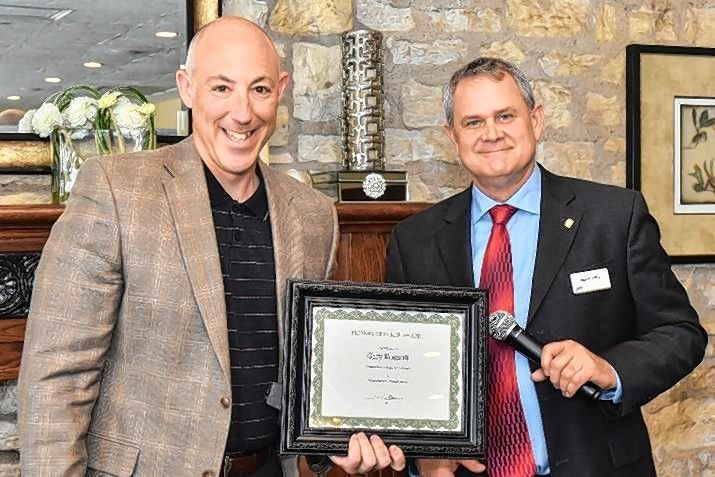 "Gary Kosnoff, left, is given the Friends of Ecker Award from chairman Alan Kirk during the Ecker Center's ""Wishes for Wellness"" brunch."