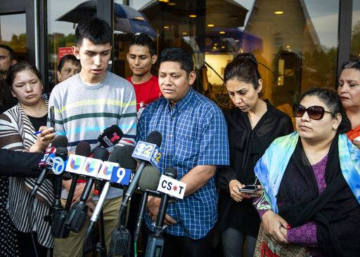 Surrounded by family members and supporters, Marlen Ochoa-Lopez's father, Arnulfo Ochoa, talks to reporters outside the Cook County medical examiner's office after identifying his daughter's body, Thursday, May 16, 2019 in Chicago. (Ashlee Rezin/Chicago Sun-Times via AP)