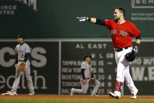 Boston Red Sox's Michael Chavis celebrates his games-ending single against the Colorado Rockies during the 10th inning of a baseball game Wednesday, May 15, 2019, at Fenway Park in Boston. The Red Sox won 6-5.