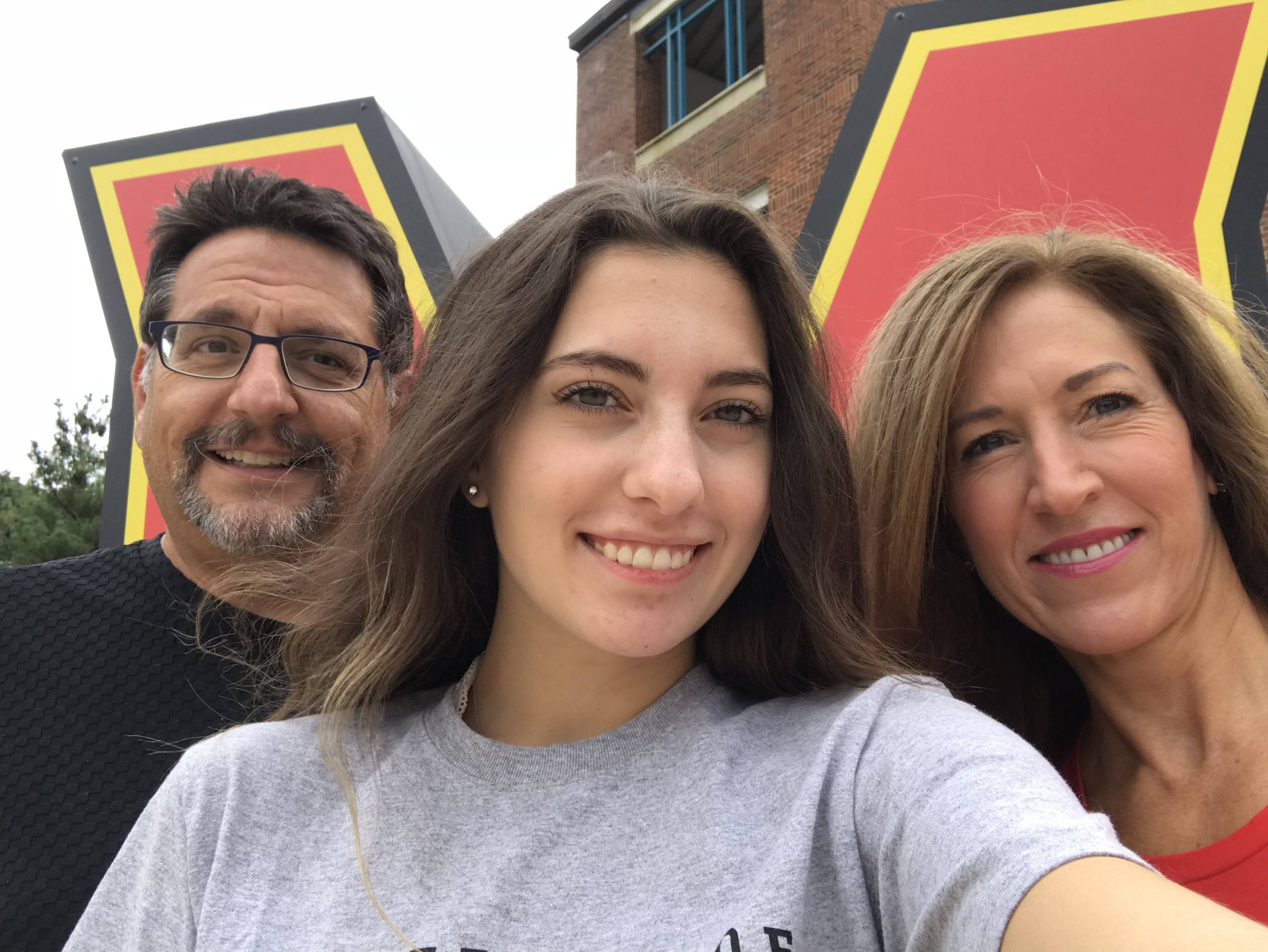 Olivia Paregol takes a selfie with her parents, Ian and Meg, at the University of Maryland in September 2018.
