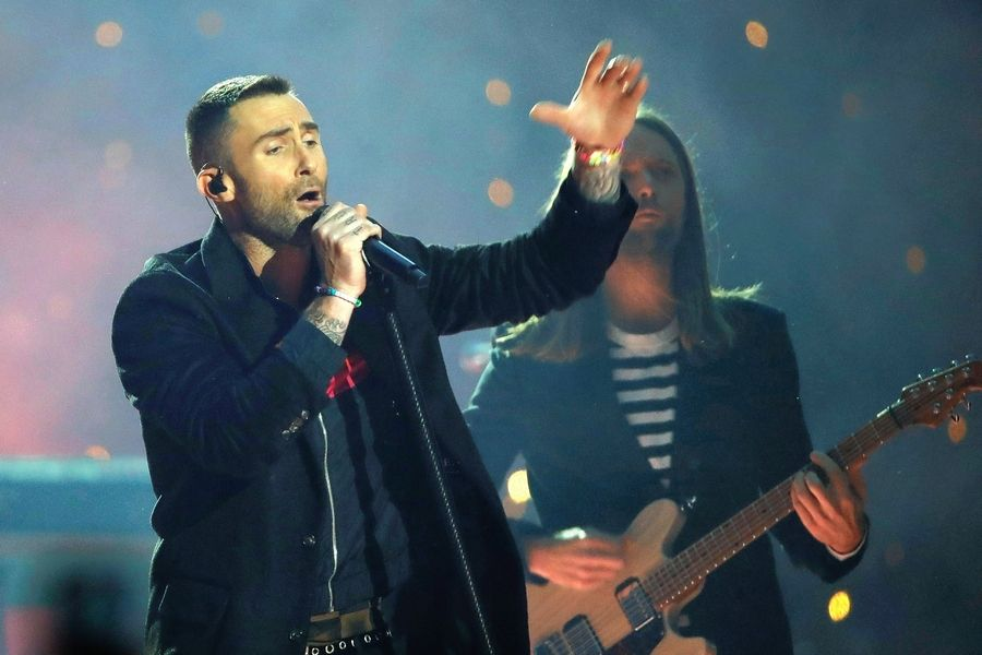 Adam Levine of Maroon 5, shown here performing during halftime of Super Bowl 53, has worked with songwriter Justin Tranter, who grew up in Hawthorn Woods.