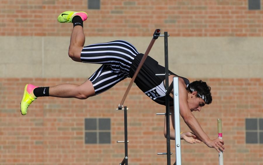 "Nate Bermes of Kaneland tops out at 14'2"" in the pole vault at the 2019 IHSA Boys Sectional at St. Charles North High School on Thursday."