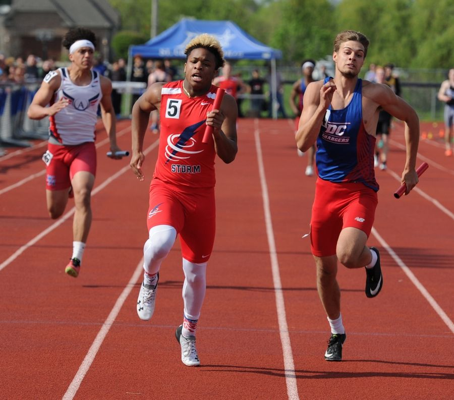 Davion Cherwin of South Elgin High School claims first with his teammates in the 4x100 meter relay heat 2 at the 2019 IHSA Boys Sectional at St. Charles North High School on Thursday.