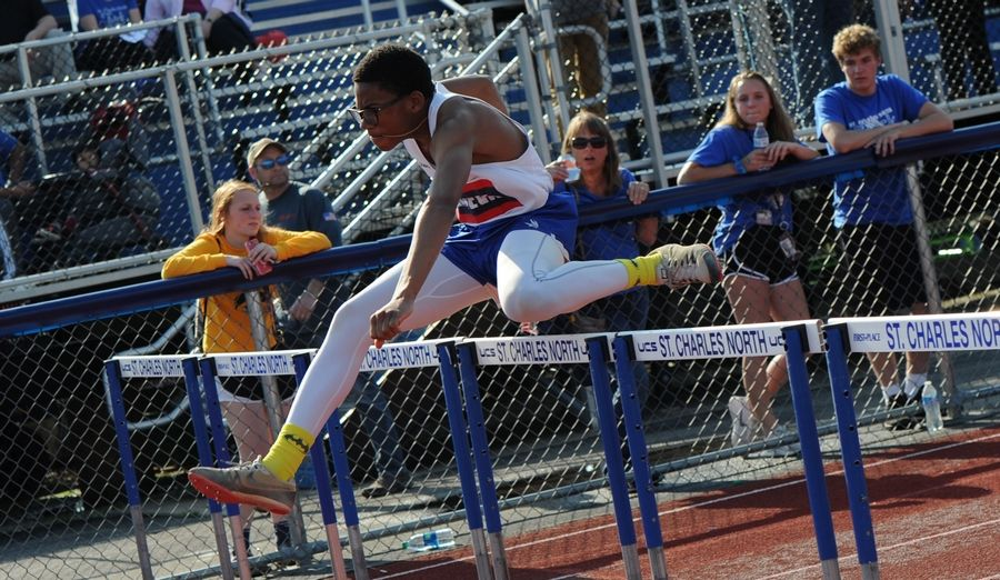 Onyi Ukaobasi of Geneva High School claims first in the 110 meter hurdles heat 4 at the 2019 IHSA Boys Sectional at St. Charles North High School on Thursday.