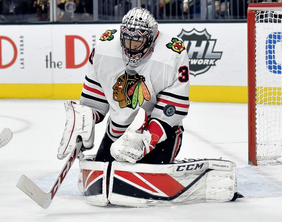 2722f8eaf21 Chicago Blackhawks goalie Jeff Glass defends against the Vegas Golden  Knights during the second period of