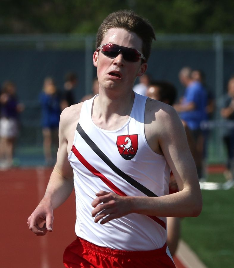 Mundelein's Dillon Blake wins the 3,200-meter run during sectional boys track action at Grant Blaney Stadium on the campus of Buffalo Grove High School Thursday night.