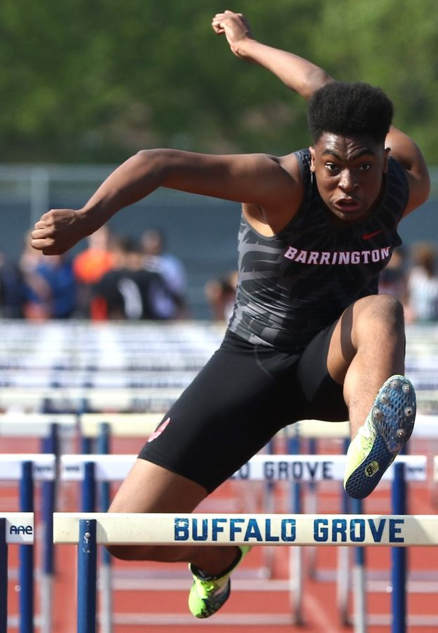 In the 110-meter hurdles is Barrington's JT McBride during sectional boys track action at Grant Blaney Stadium on the campus of Buffalo Grove High School Thursday night.