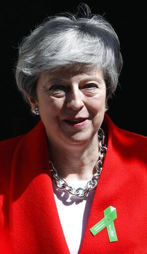 Britain's Prime Minister Theresa May leavse 10 Downing Street for her weekly Prime Minister's Questions at the House of Commons in London, Wednesday, May 15, 2019.