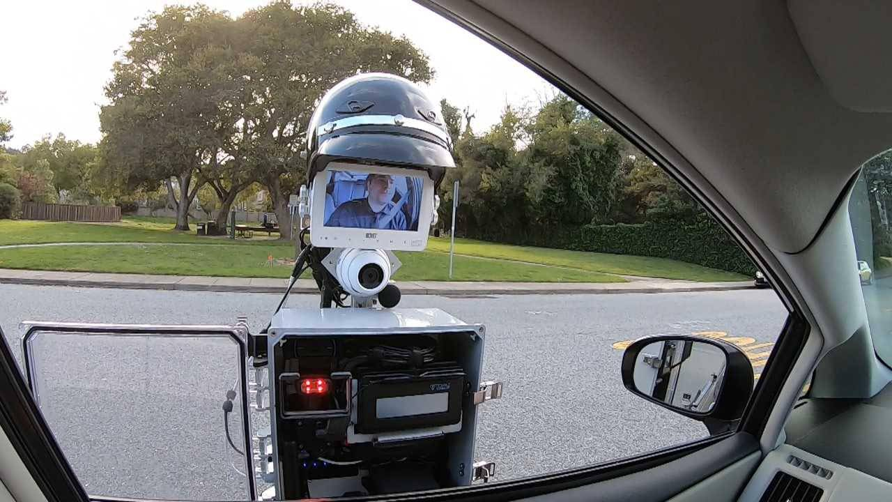 The GoBetween robot extends out from the police vehicle to the car that has been pulled over. When the encounter is done, the entire contraption retracts and the robot returns to the police car.
