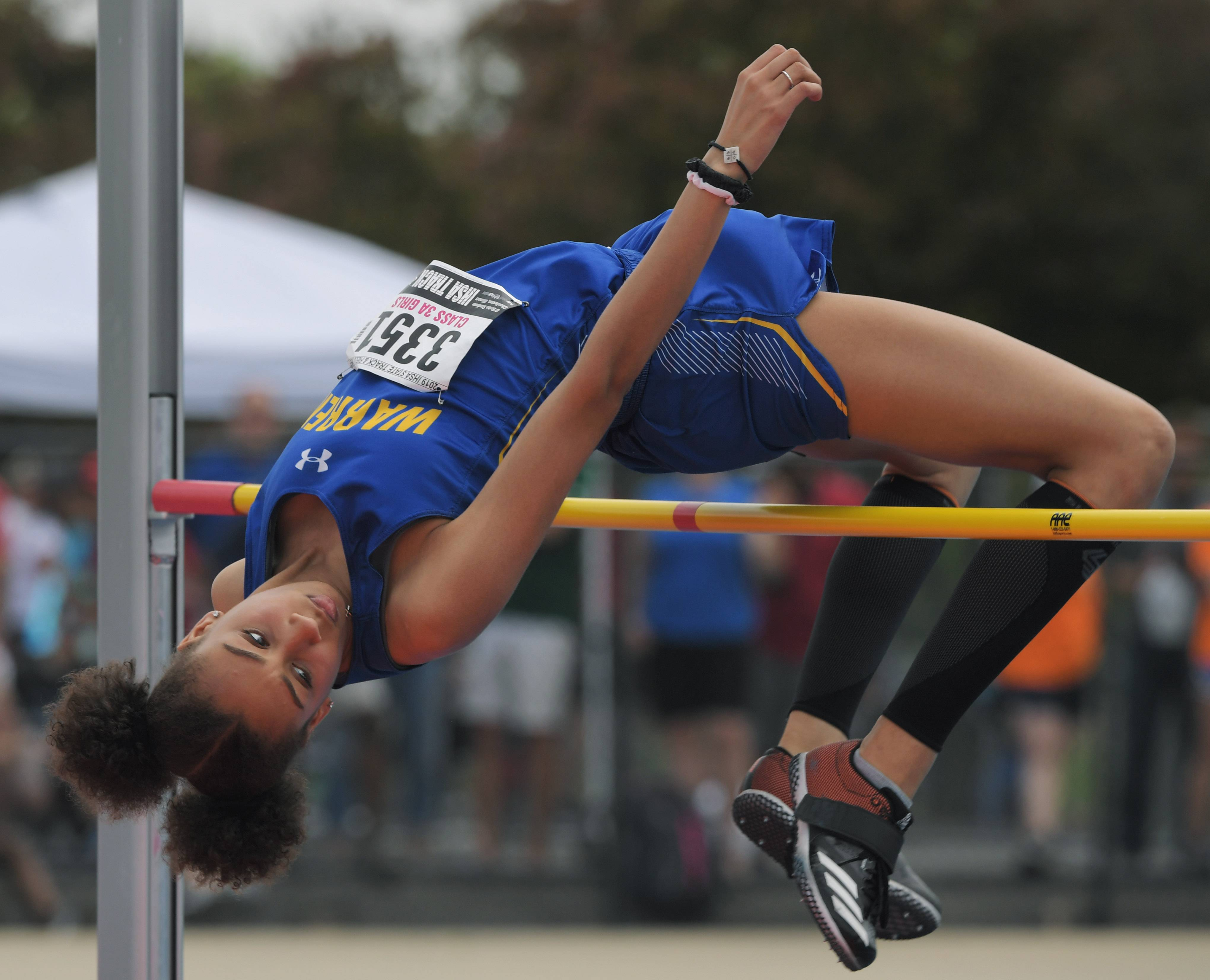 Warren's Annika Bynum clears the bar while competing in the high jump during the Class 3A girls state track and field preliminaries in Charleston Friday.
