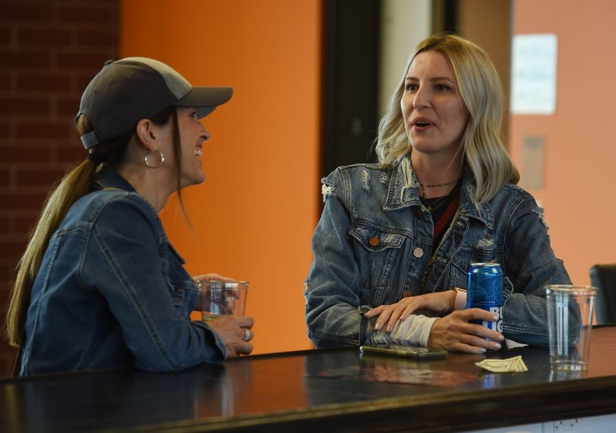 Dottie Beck, left, and Nicole Woolrich, both of Schaumburg, have a drink in the Jim Beam Club on Tuesday, opening night of the Schaumburg Boomers' 2019 season.