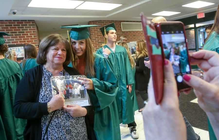 Seniors in their caps and gowns returned Friday to Hunting Ridge Elementary School in Palatine.