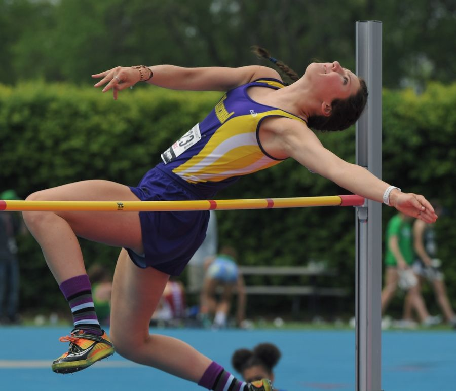 Wauconda's Grace Daun clears the bar while competing in the high jump during the Class 3A girls state track and field preliminaries in Charleston Friday.