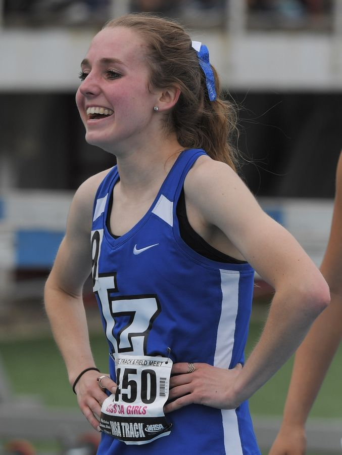 Lake Zurich's Sydney Mark smiles at the conclusion of the 400-meter dash during the Class 3A girls state track and field preliminaries in Charleston Friday.
