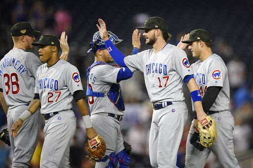 Chicago Cubs' Kris Bryant (17) celebrates with Mike Montgomery (38), Addison Russell (27), Willson Contreras (40) and Anthony Rizzo (44) after a baseball game against the Washington Nationals, Friday, May 17, 2019, in Washington.
