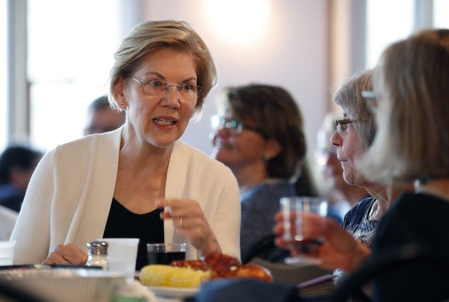 Democratic presidential candidate Sen. Elizabeth Warren, Massachusetts, speaks with a group of women Saturday at the Rockingham County Democrats Clambake, in Portsmouth, N.H.  Warren was one of the first to enter the now-crowded presidential race.